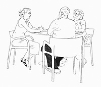 Three people sitting at table discussing.ExclusiveImage