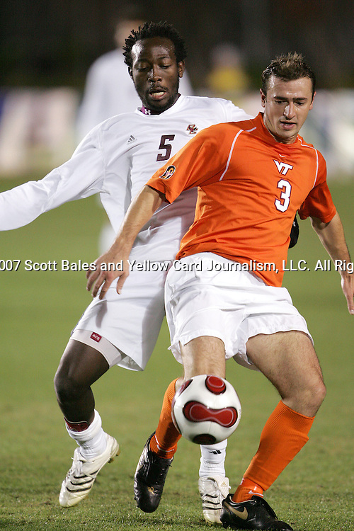 16 November 2007: Virginia Tech's Georg Zehender (3) screens Boston College's Reuben Ayarna (5) away from the ball. Boston College defeated Virginia Tech 3-1 at SAS Stadium in Cary, NC in an Atlantic Coast Conference Men's Soccer tournament semifinal.