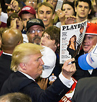 PENSACOLA, FL - SEPTEMBER 09: Republican Presidential candidate Donald Trump autographs a Playboy Magazine for a supporter after his rally at the Pensacola Bay Center on September 9, 2016 in Pensacola, Florida.  The rally drew a full house of more than 12,000 supporters. (Photo by Mark Wallheiser/Getty Images)