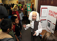Note: Broome, Ashlynn are correct.<br /> STAFF PHOTO FLIP PUTTHOFF <br /> CHARACTERS OF COURAGE<br /> Eli Broome plays the role of Benjamin Franklin on Wednesday Dec. 17 2014 during a living history museum at Greer Lingle Middle School in Rogers. Sixth-grade students researched characters with courageous traits and dressed like them. Each student recited a lesson about their character for visiting fifth-grade students from several Rogers elementary schools, said Karie Harrison, a teacher at Lingle. Ashlynn Robinson, second from right, plays the role of Geronimo.