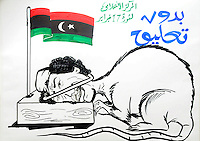 A cartoon drawing of Gaddifi by artist Kiasi Al-Hali, who was killed of 20th February. On 17 February 2011 Libya saw the beginnings of a revolution against the 41 year regime of Col Muammar Gaddafi.