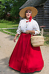 Old Bethpage, New York, USA. 30th August, 2015. JANET DEMAREST is the Storyteller of local Long Island Legends during the Old Time Music Weekend at Old Bethpage Village Restoration. Demarest carried a woven straw basket and wore a large brim straw sun hat, blouse with lace trim, and long red hoop skirt in the style of the mid 19th Century.