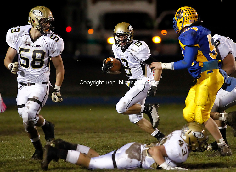 Seymour, CT-23 November 2011-112311CM04- Woodland's Anthony Scirpo (8) looks for an open hole Wednesday night in Seymour. Blocking is Vigian Mulahu (58) as Seymour's Zach Sirowich (54) rushes in to make the tackle. Woodland won 28-7. Christopher Massa Republican-American