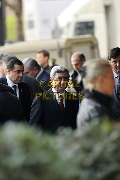 SERZH SARGSYAN, President of the Republic of Armenia .Arriving at the Dorchester Hotel under a massive security operation, London, England..February 10th, 2010.politics politician bodyguards black blue coat half length.CAP/DYL.©Dylan/Capital Pictures.