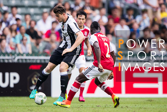 Juventus' player Alberto Cerri battles South China's player Agbo Wisdom Fofo during the South China vs Juventus match of the AET International Challenge Cup on 30 July 2016 at Hong Kong Stadium, in Hong Kong, China.  Photo by Marcio Machado / Power Sport Images