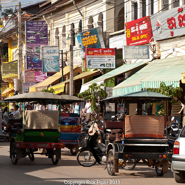 Tuk-tuks in the main shopping and restaurant street near the old market, Siem Reap, Cambodia