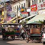 Tuk-tuks in the main shopping and restaurant street near the old market, Siem Reap, Cambodia