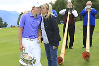 Matthew Fitzpatrick (ENG) gets a kiss from his mum after he wins the tournament after a 3 hole playoff at the  end of Sunday's Final Round of the 2017 Omega European Masters held at Golf Club Crans-Sur-Sierre, Crans Montana, Switzerland. 10th September 2017.<br /> Picture: Eoin Clarke | Golffile<br /> <br /> <br /> All photos usage must carry mandatory copyright credit (&copy; Golffile | Eoin Clarke)