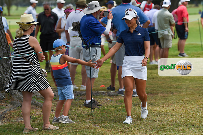 Danielle Kang (USA) fist bumps a young fan enroute to the tee on 2 during round 2 of the 2019 US Women's Open, Charleston Country Club, Charleston, South Carolina,  USA. 5/31/2019.<br /> Picture: Golffile | Ken Murray<br /> <br /> All photo usage must carry mandatory copyright credit (© Golffile | Ken Murray)