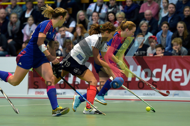 GER - Luebeck, Germany, February 07: During the 1. Bundesliga Damen indoor hockey final match at the Final 4 between Mannheimer HC (blue) and Duesseldorfer HC (white) on February 7, 2016 at Hansehalle Luebeck in Luebeck, Germany. Final score 6-4 after shootout.  (R-L) Sophia Willig #9 of Mannheimer HC, Lisa-Marie Schuetze #19 of Duesseldorfer HC, Vera Battenberg #64 of Mannheimer HC