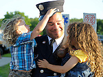 Somers firefighter Ray Stovall, gets the business from his two young kids, Ella, 4,  and Nathan, 2, who can't resist knocking off his cap, part of his formal uniform, Monday evening, Jube 30, 2014,  outside the Somers firehouse. Moments earlier Stovall received the medal of valor for his part in rescuing a woman from a burning home last December in Somersville. (Jim Michaud / Journal Inquirer)