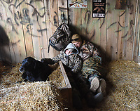 NWA Democrat-Gazette/FLIP PUTTHOFF<br /> Jacob Shastid, 12, and his dad, Ray Shastid, catch some shut-eye Feb. 3 2018 in the duck blind. Magnum rests on his straw dog beg. The group met at 6 a.m. to start their hunt.