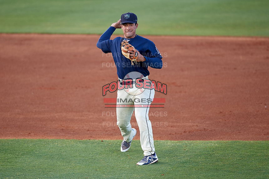 Mobile BayBears second baseman Jahmai Jones (15) throws to first base during a Southern League game against the Jacksonville Jumbo Shrimp on May 7, 2019 at Hank Aaron Stadium in Mobile, Alabama.  Mobile defeated Jacksonville 2-0.  (Mike Janes/Four Seam Images)