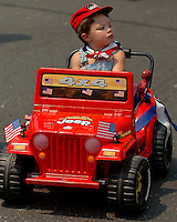 A boy rides his decorated jeep in the annual Fourth of July Celebration and community parade in Birkdale Village in Huntersville, NC. Birkdale Village combines the best of shopping, dining, apartments and entertainment venues within a 52-acre mixed-use development.