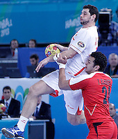 Egypt's Ibrahim Mohamed (r) and Spain's Alberto Entrerrios during 23rd Men's Handball World Championship preliminary round match.January 14,2013. (ALTERPHOTOS/Acero) /NortePhoto