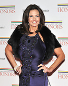 Washington, DC - December 5, 2009 -- Lynda Carter arrives for the formal Artist's Dinner at the United States Department of State in Washington, D.C. on Saturday, December 5, 2009..Credit: Ron Sachs / CNP.(RESTRICTION: NO New York or New Jersey Newspapers or newspapers within a 75 mile radius of New York City)