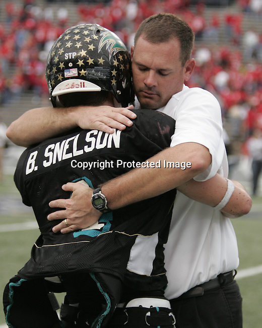Pasadena's Bo Snelson is comforted by his coach after Katy defeated Pasadena 30-14  at Rice Stadium December 1, 2007 (Freelance/Margaret Bowles)
