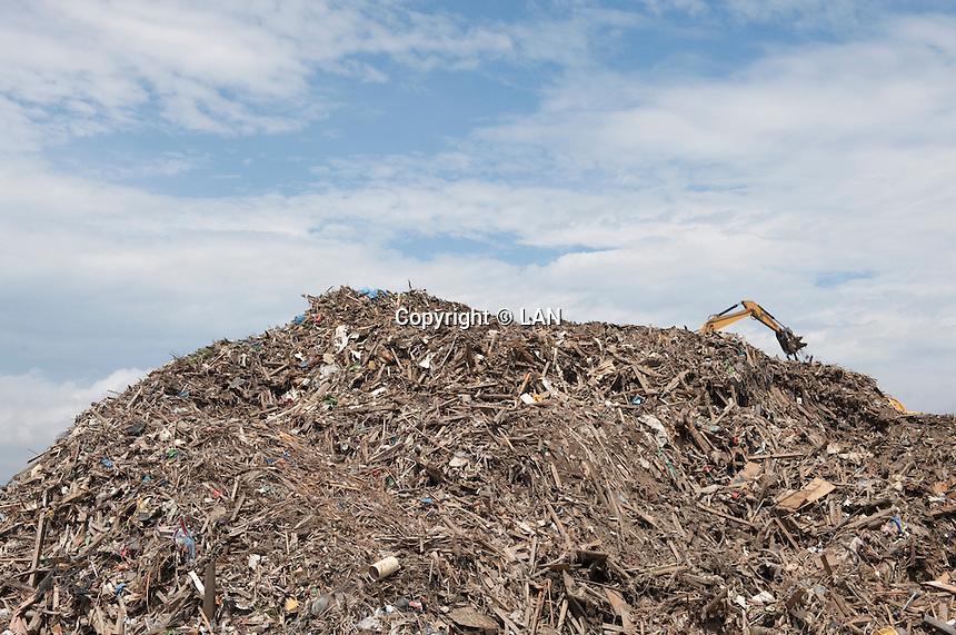 Construction vehicles create a pile of debris during reconstruction efforts following the 311 Tohoku Tsunami in Rikuzentakata, Japan  © LAN