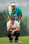 TAOYUAN, TAIWAN - OCTOBER 27:  Suzann Pettersen of Norway lines up a putt walks on the 17th green with her caddie Brian Dilley during the day three of the Sunrise LPGA Taiwan Championship at the Sunrise Golf Course on October 27, 2012 in Taoyuan, Taiwan.  Photo by Victor Fraile / The Power of Sport Images