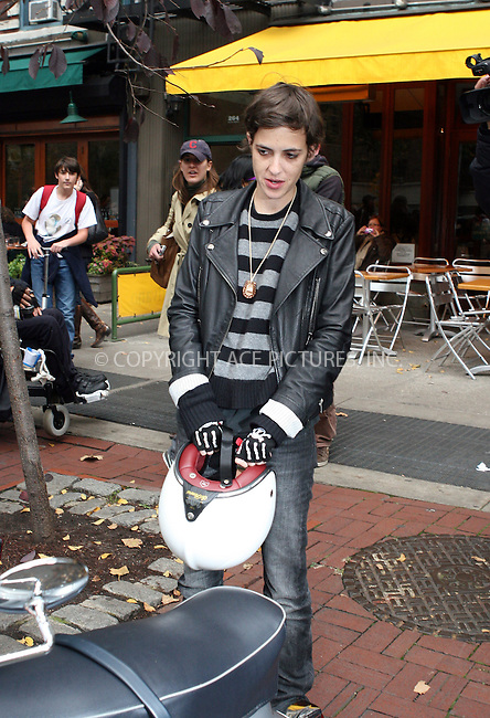 WWW.ACEPIXS.COM . . . . .  ....October 30 2009, New York City....DJs Samantha Ronson and Mark Ronson leave Soho Restaurant Bar Pitti and ride off on Mark's Vepsa amid great paparazzi attention on October 30 2009 in New York City....Please byline: NANCY RIVERA- ACEPIXS.COM.... *** ***..Ace Pictures, Inc:  ..Tel: 646 769 0430..e-mail: info@acepixs.com..web: http://www.acepixs.com