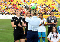Coast Guard representative presents the ball to the referee during the WPS All-Star game at KSU Stadium in Kennesaw, Georgia on June 30 2010. Marta XI won 5-2.