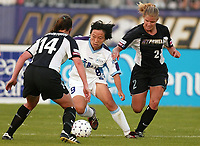 Sun Wen of the Atlanta Beat being double teamed by Wynne McIntosh and Kristy Whelchel of the New York Power during the Power's 2-0 loss at Mitchel Athletic Complex on June 9th.