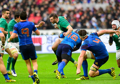 13.02.2016. Stade de France, Paris, France. 6 Nations Rugby international. France versus Ireland.  Robbie Henshaw ( Ireland ) brought down by Eddy Ben Arous ( France )