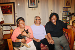 Lisa McNair (left to right) hugs her dog Banjo next to her mother Maxine and sister Kimberly Brock in her Birmingham, Alabama home August 13, 2013. Lisa's sister Denise McNair was the youngest victim who died in a bomb blast at 16th Street Baptist Church September 15, 1963.