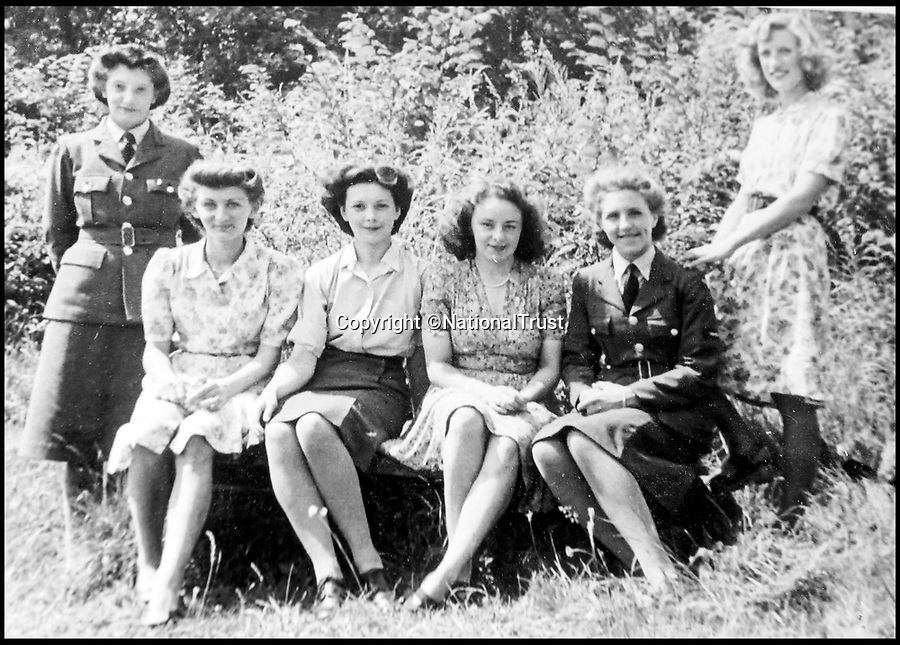 BNPS.co.uk (01202 558833)<br /> Pic: NationalTrust/BNPS<br /> <br /> Top Secret  - Edna Howlett (3rd left) with fellow RAF and civilian workes at Hughenden.<br /> <br /> Secret rooms at a stately home where brilliant map-makers played a pivotal role in helping Britain to win the war have been opened to the public for the first time.<br /> <br /> Hughenden Manor, in Bucks, once home to the Victorian prime minster Benjamin Disraeli, was requisitioned by the Air Ministry in 1941 and given the codename 'Hillside'.<br /> <br /> In its confines, more than 3,500 hand drawn maps were produced for the RAF bombing campaigns, including the legendary Dambusters Raid and a raid on the Berchtesgaden, Hitler's famous mountain retreat.<br /> <br /> Previously hidden away under lock and key, these rooms have been opened for the first time for a permanent display featuring photographs, records and testimonies from some of the 100 men and women who were based there in World War Two.<br /> <br /> Since they were sworn to silence under the Official Secrets Act, Hillside's crucial wartime role in fact remained unknown until 2004, when a volunteer room guide overheard Victor Gregory, a visitor to the National Trust property, tell his grandson that he was stationed there during the war.