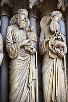 North Porch, Central Portal, right Jambs- General View c. 1194-1230. Cathedral of Chartres, France . Gothic statues of figures, from left,  of Simeon holding the Christ Child and  John the Baptist holding the Agnus Dei. A UNESCO World Heritage Site.