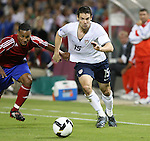 11 October 2008: Heath Pearce (USA) (15) has his jersey held by Yoel Colome (CUB) (left). The United States Men's National Team defeated Cuba Men's National Team 6-1 at RFK Stadium in Washington, DC in a CONCACAF semifinal round FIFA 2010 South Africa World Cup Qualifier.