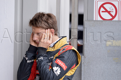 05.07.2013. Nurburgring, Germany.  French Formula One driver Romain Grosjean of Lotus covers his ears from noise during the second practice session at the Nuerburgring race track, Nuerburg, Germany. The Formula One Grand Prix of Germany will take place on 7th of July 2013.