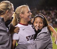 Santa Clara, CA - September 22, 2013:  Teammates congratulate Courtney Verloo after her hat trick in Stanford's 3-2 double overtime victory over Santa Clara at Buck Shaw Stadium, Santa Clara.