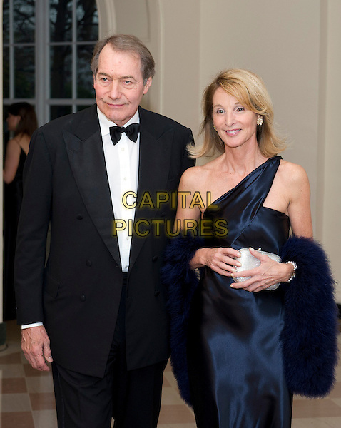Charlie Rose and Amanda Burden .arriving for the Official Dinner in honor of Prime Minister David Cameron of Great Britain and his wife, Samantha, at the White House in Washington, D.C., USA, March 14th, 2012..half length black tuxedo tux bow tie suit   blue navy one shoulder dress fur wrap .CAP/ADM/CNP/RS.©Ron Sachs/CNP/AdMedia/Capital Pictures.