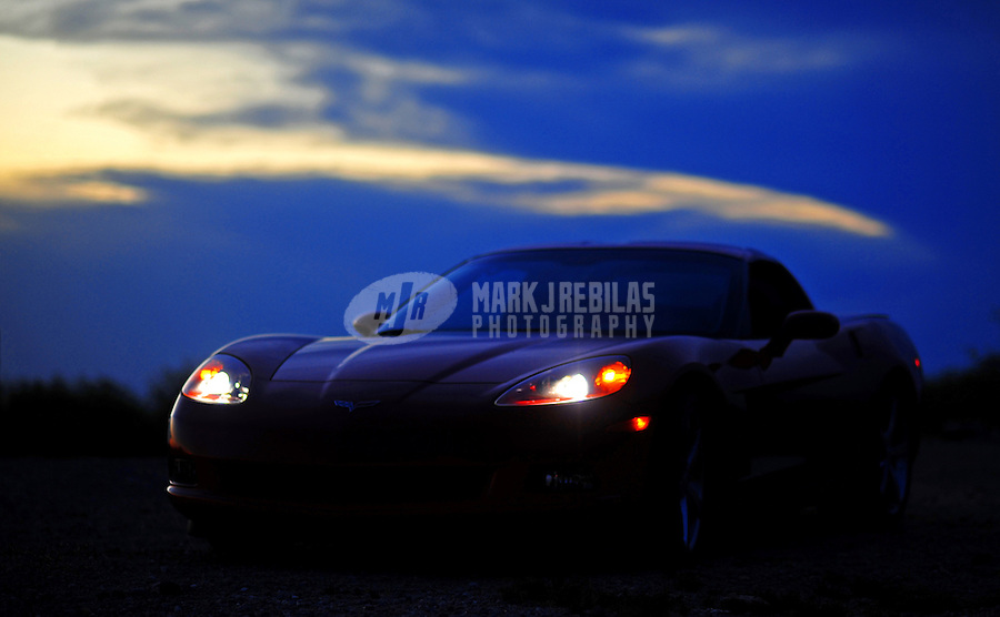 desert weather storm chaser chasing clouds sky Arizona mountain mountains red Chevy Chevrolet Corvette 2008 sports car coupe dirt road gravel automobile automotive night headlights