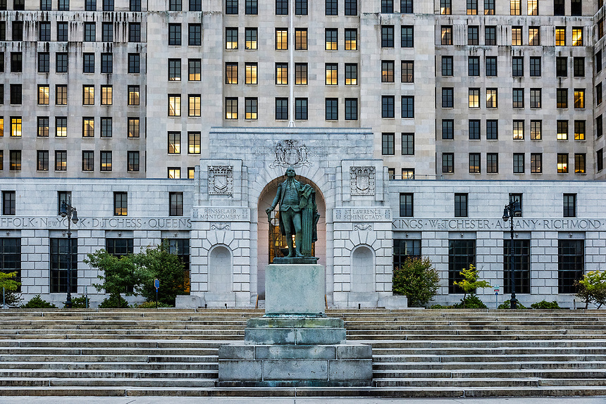 George Washington statue flanked by the New York State Criminal Justice building, Albany, New York, USA.