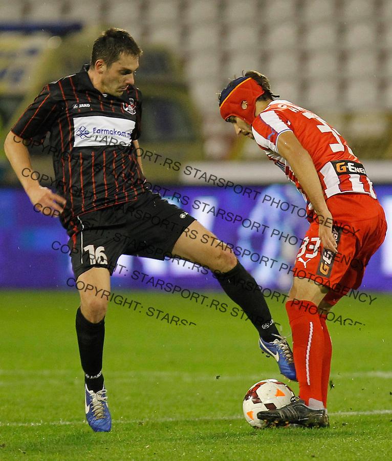 Fudbal Super liga season 2013-2014<br /> Crvena Zvezda v Sloboda Uzice<br /> Milos Zeravica (L) and Milos Ninkovic<br /> Beograd, 23.11.2013.<br /> foto: Srdjan Stevanovic/Starsportphoto &copy;