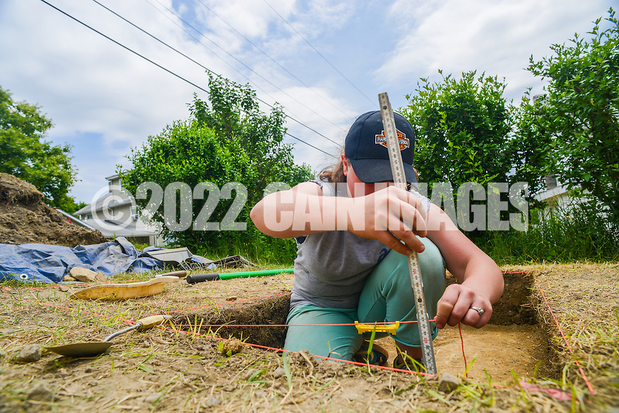 HAZLETON, PA - JUNE 30:   Teresa Robbins works at the site of an archaeologic dig June 30, 2014 in Hazleton, Pennsylvania. The team is looking through sites connected with the Lattimer Massacre which occurred in 1897. (Photo by William Thomas Cain/Cain Images)