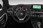 Car pictures of steering wheel view of a 2016 BMW 3 Series 328i 4 Door Sedan Steering Wheel