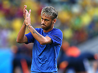 Neymar of Brazil applauds the fans as he warms up