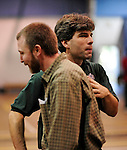 8 November 2009: VCS coach Peter Goff (right) congratulates Enosburg coach Jason Robtoy after the 2009 High School Volleyball State Championships hosted by Vermont Commons School at the Sports and Fitness Edge in South Burlington, Vermont. The Enosburg Falls Hornets successfully defended their boys' title while the VCS Flying Turtles rallied to maintain their girls' team crown. Mandatory Credit: Ed Wolfstein Photo