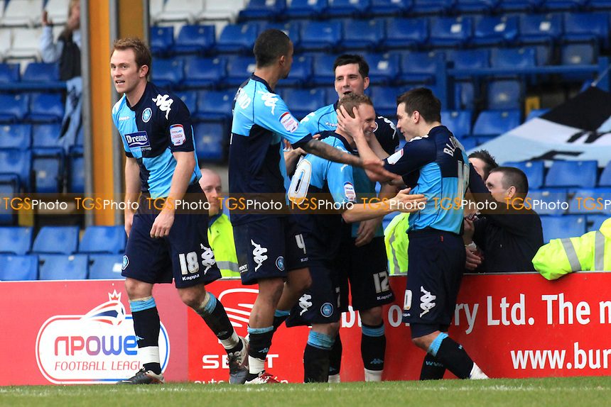 Wycombe players embrace goalscorer, Stuart Beavon after scoring the 4th goal - Bury vs Wycombe Wanderers - nPower League One Football at Gigg Lane, Bury, Lancashire - 17/03/12 - MANDATORY CREDIT: Paul Dennis/TGSPHOTO - Self billing applies where appropriate - 0845 094 6026 - contact@tgsphoto.co.uk - NO UNPAID USE.