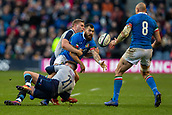 2nd February 2019, Murrayfield Stadium, Edinburgh, Scotland; Guinness Six Nations Rugby Championship, Scotland versus Italy; Tito Tebaldi of Italy is tackled by Ali Price of Scotland and passes to Sergio Parisse of Italy