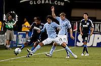 Ryan Johnson (19) tries to keep the ball in play against Mendl Ballouchy (8). San Jose Earthquakes tied the Colorado Rapids 1-1 at Buck Shaw Stadium in Santa Clara, California on September 18, 2009.