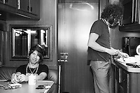 Brent DeBoer heats up leftover barbeque with Peter Holmstrom of The Dandy Warhols on their tour bus outside the Mercy Lounge in Nashville, Tennessee on May 5th, 2014.