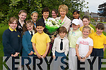 RETIRING: Pupils said a tearful farewell to their principal, Marie McSwiney in Balloonagh Primary School on friday.afternoon. From front l-r were: Nikki Breen, Nicole Keaney, Michael Sheehan, Dara Barry Walsh, Shauna Enright, Sarah.Enright and Geraldine Knightly. Back l-r were: Kayla O'Brien, Mckenzie Keane, Rena O'Connell, Rebecca Shortt, Marie.McSwiney (retiring principal), Michaela Toravoka and Sarah O'Donoghue.