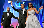 United States President Barack Obama (C) and first lady Michelle Obama wave as they greet U.S. Representative Chaka Fattah (Democrat of Pennsylvania) as they arrive on stage for the Congressional Black Caucus Foundation Annual Phoenix Awards dinner, September 21, 2013, Washington, DC. The CBC's annual conference brings together activists, politicians and business leaders to discuss public policy impacting black communities in America and abroad. <br /> Credit: Mike Theiler / Pool via CNP