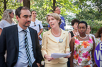 Democratic NYS gubernatorial candidate Zephyr Teachout, center,  with Lt. Gov. candidate Tim Wu, left, and NOW-NYS Pres.  Zenaida Mendez at a news conference in New York on Tuesday, August 26, 2014  about receiving the endorsement of the National Organization of Women-NYS in her candidacy for governor of New York State. Teachout, a Fordham University law professor is considered a long shot in the Democratic primary on Sept. 9 against well-funded incumbent Gov. Andrew Cuomo but supporters encourage voters to cast their ballot as a vote against Cuomo. The event was held at the Eleanor Roosevelt statue in Riverside Park on Women's Equality Day. (© Richard B. Levine)