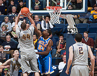 Tony Parker of UCLA tries to block CAL's Kameron Rooks's ball during the game at Haas Pavilion in Berkeley, California on February 19th, 2014.  UCLA defeated California, 86-66.