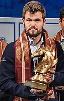 26th November 2019, Kolkata, India, Grand Master Tata Steeel Chess tournament;  Carlsen Magnus of Norway poses with the winning trophy at Tata Steel Chess India 2019 in Kolkata, India